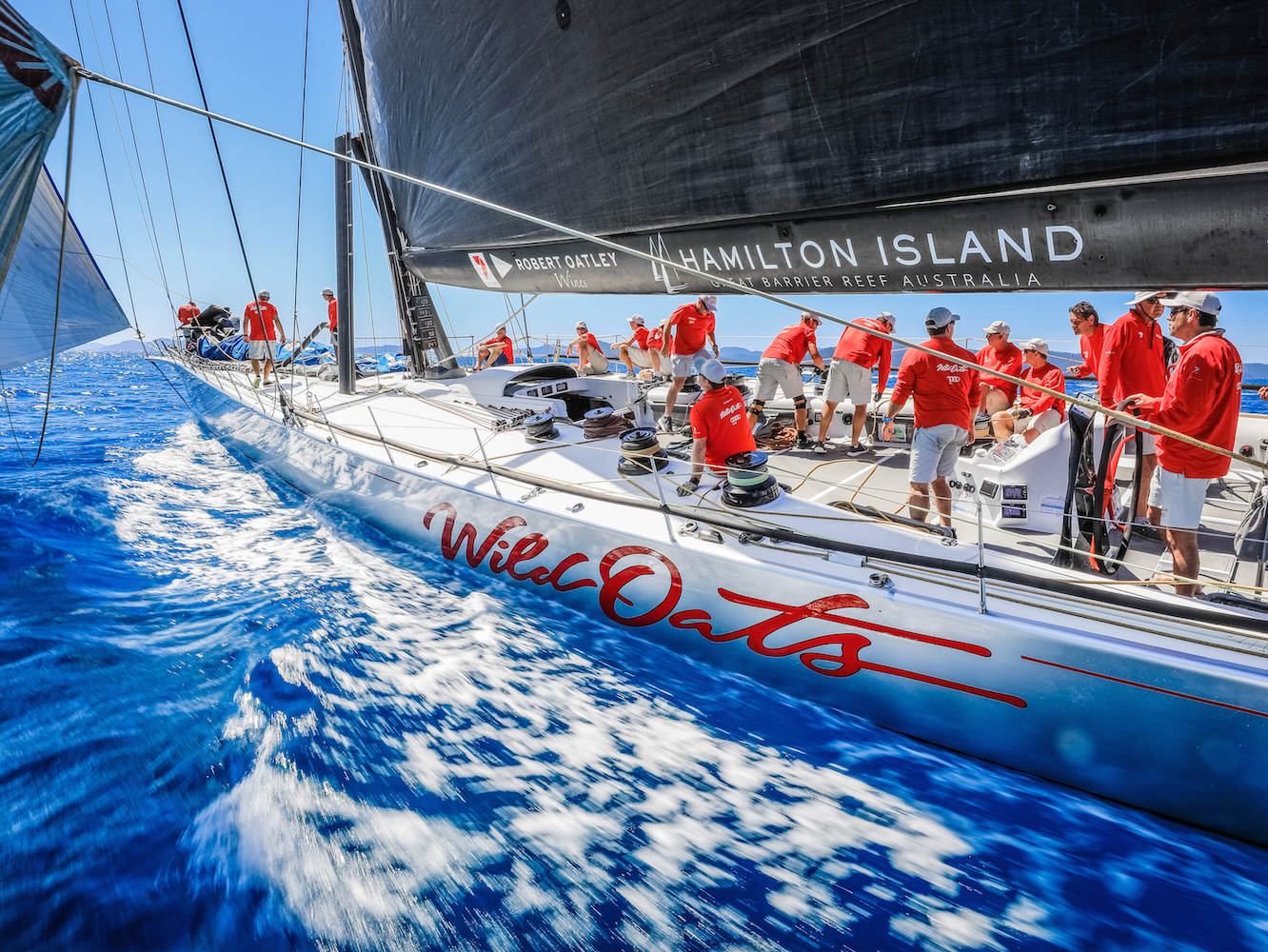 Repaired supermaxi yacht, Wild Oats XI, sets sail on overnight qualifier for the Rolex Sydney-Hobart Yacht Race